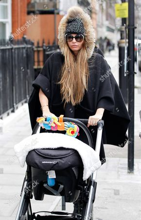 Stock Photo of Katie Price with baby son Jett in a pushchair with son Jett Riviera