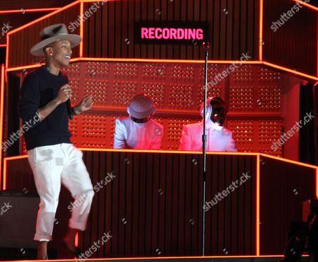 Pharrell Williams and Guy-Manuel de Homem-Christo and Thomas Bangalter of 'Daft Punk' performing