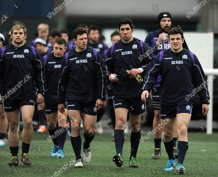Scotland players - Pat MacArthur, Nick de Luca, Kelly Brown (captain) and Matt Scott walk out for the start of the session