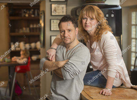 Stock Picture of The comedian, writer and broadcaster Jon Holmes with his wife Nicki