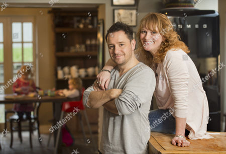 Stock Photo of The comedian, writer and broadcaster Jon Holmes with his wife Nicki