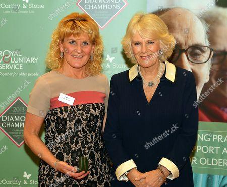 Stock Photo of Camilla Duchess of Cornwall with Linda Swift the daughter of Diamond Champion Robert Johnstone from Cumbernauld