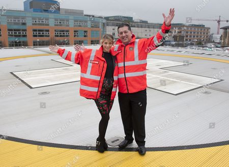 Melanie Slade on the hospital helipad with Andy Williamson, Chief Executive of the Children's Air Ambulance Service