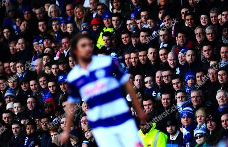 Stock Photo of QPR fans look towards Nico Kranjcar