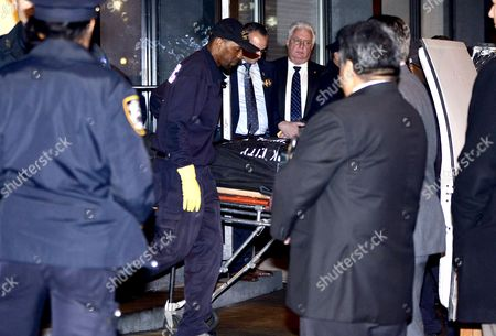 Stock Image of Philip Seymour Hoffman's body is brought out of his West Village apartment