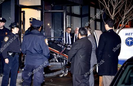 Stock Picture of Philip Seymour Hoffman's body is brought out of his West Village apartment