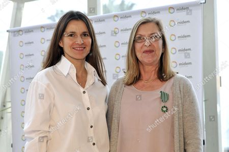Stock Image of French Minister Aurore Filipetti and producer, Alison Wenham with her Chevalier of the Order of Arts and Letters medal
