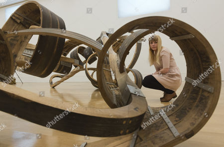 A member of staff looks at 'Out of Order', 2003, by Richard Deacon