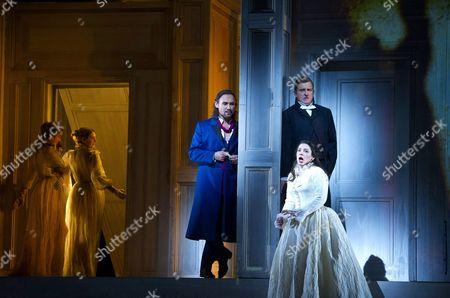 Stock Image of Mariusz Kwiecien as Don Giovanni, Dawid Kimberg as Masetto and Elizabeth Watts as Zerlina