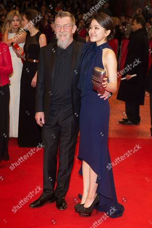 Stock Image of John Hurt and Ko Ah-seong