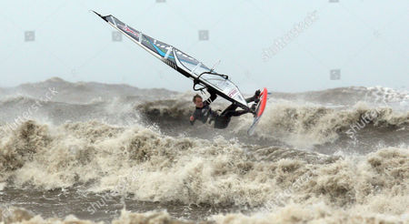A brave Chris Murray goes windsurfing in the heavy seas