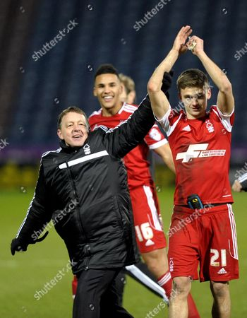 Manager Billy Davies of Nottingham Forest celebrates with double goalscorer Jamie Paterson of Nottingham Forest and the away fans
