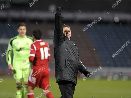 Manager Billy Davies of Nottingham Forest celebrates with the fans at the end of the game