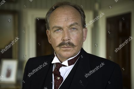 Stock Picture of Patrick Ryecart as Sir Anthony Morgan.