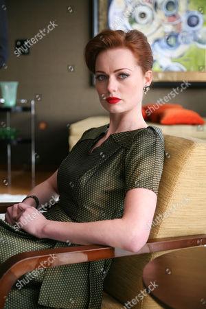 Rosalind Halstead as Claudia Hardcastle.