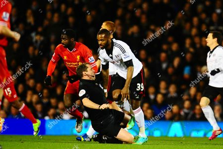 Stock Picture of Referee Mark Halsey falls over after colliding with Darren Bent of Fulham