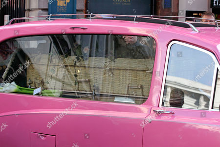 Pink hearse carrying the coffin