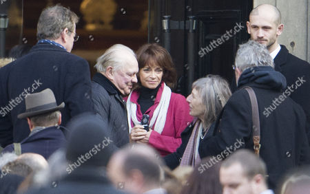 David Jason being greeted by Jehane Markham at the church, with Sue Holderness