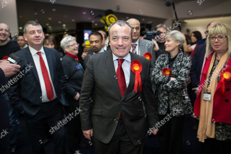Labour's Mike Kane enters the counting hall