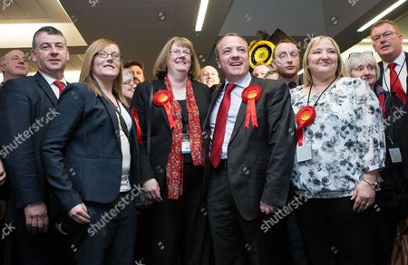 Labour's Mike Kane celebrates with his wife Sandra Bracegirdle and Labour supporters