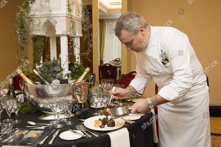 Nigel Boschetti, Executive Chef at Grosvenor House, A JW Marriott Hotel with main course of fillet of Aberdeen Angus, braised short rib, red wine sauce, porcini and potato gratin, roast shallots, stem broccoli at the BAFTA dinner table setting
