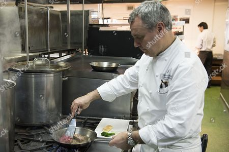 Nigel Boschetti, Executive Chef at Grosvenor House, A JW Marriott Hotel cooking in the kitchen