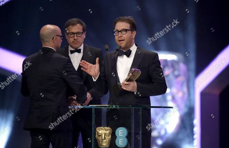 David O Russell and Eric Warren Singer with Stanley Tucci