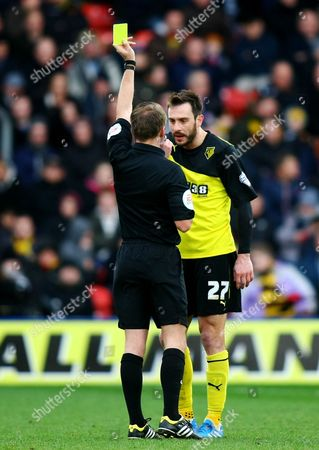 Watford's Marco Cassetti is shown a yellow card by referee Olivier Langford