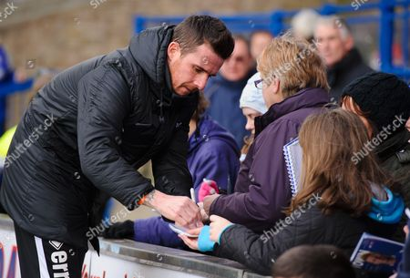 Stock Photo of Blackpool Player Manager Barry Ferguson signs autographs for fans