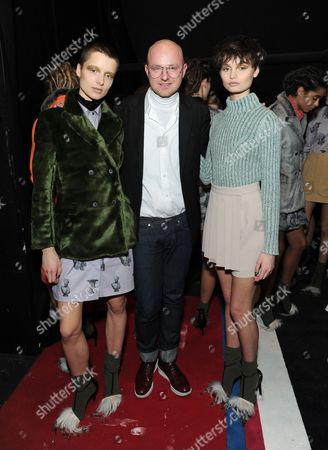 Creative Director Geoffrey J. Finch and models backstage