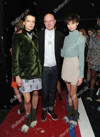 Stock Photo of Creative Director Geoffrey J. Finch and models backstage