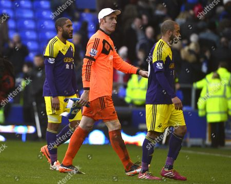 Swansea City's Ashley Williams, Gerhard Tremmel and Ashley Richards look dejected as they leave the pitch