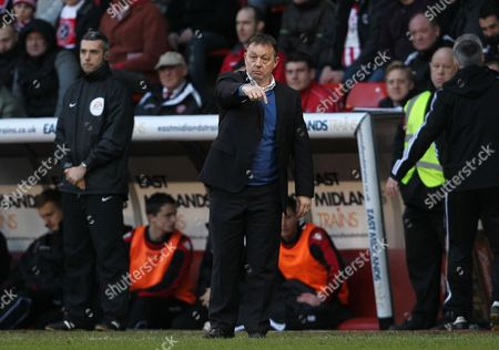 Nottingham Forest manager Billy Davies points downwards