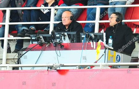 TV presenter Andy Gray looks on from his position high up in the stands
