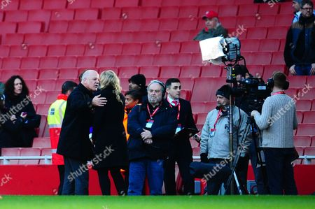 Andy Gray kisses the BT Sport presenter after giving his views on the Arsenal v Liverpool match