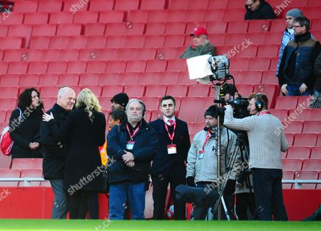 Andy Gray smiles at the BT Sport presenter during an interview pitchside ahead of the Arsenal v Liverpool match