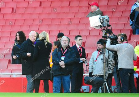 Andy Gray on duty for BT Sport during an interview pitchside ahead of the Arsenal v Liverpool match
