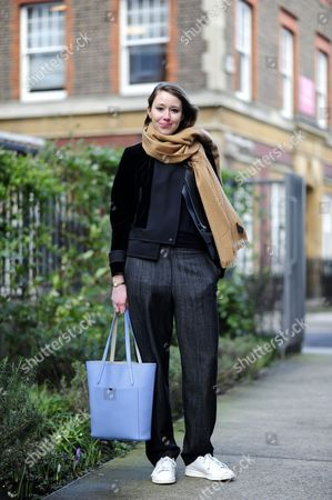 Editorial image of Street Style at London Fashion Week Autumn Winter 2014, Britain - Feb 2014