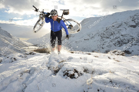 Mark Beaumont cycling in Perthshire