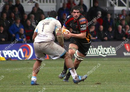 Cory Hill of Newport Gent Dragons looks for a way past Jerry Yanuyanutawa of Glasgow Warriors.