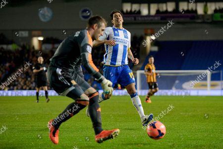 Hull City Goalkeeper Allan McGregor gets to the ball before the oncoming Leonardo Araujo Ulloa of Brighton & Hove Albion
