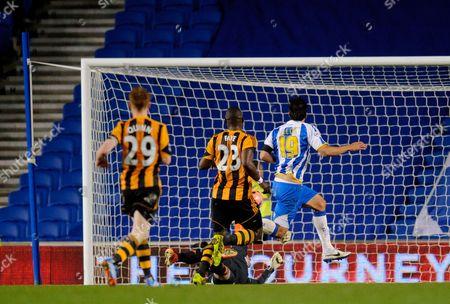 Leonardo Araujo Ulloa of Brighton & Hove Albion scores the opening goal, 1-0