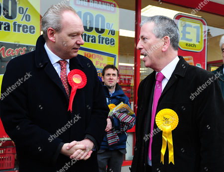 Stock Image of John O'farrell The Labour Candidate (left) Meets Mike Thornton The Lib Dem Candidate (right) Whilst Out Campaigning In Eastleigh Town Centre. Candidates From Each Of The Different Parties Are Campaigning For Their Votes In Eastleigh To Replace Chris Huhne. Eastleigh  UK  13/02/2013 Hampshire 2013.