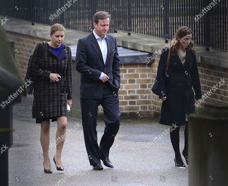 David Cameron MP PM returning back to Downing st via the backdoor with Kate Fall (right) and (left) Liz Sugg