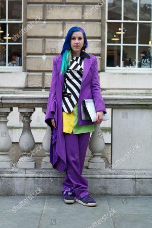 Editorial photo of Street Style at London Fashion Week Autumn Winter 2014, Britain - Feb 2014
