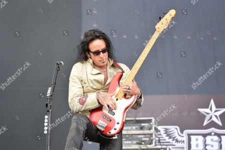 Castle Donington United Kingdom - June 15: Bassist Marco Mendoza Of American Rock Group Black Star Riders Performing Live On The Main Stage At Download Festival On June 15