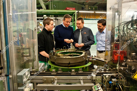 Prime Minister David Cameron talks to factory worker Tom Griffiths, Factory Director Neil Barnes and MP Stephen Crabb