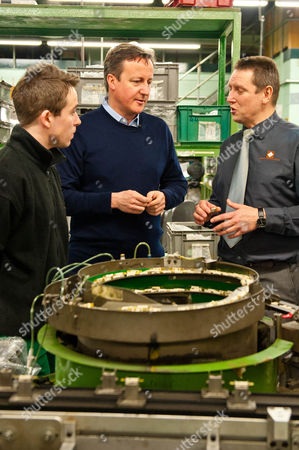 Prime Minister David Cameron talks to factory worker Tom Griffiths, Factory Director Neil Barnes