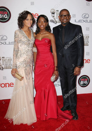 Forest Whitaker and Keisha Whitaker with their daughter