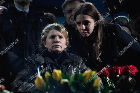Former Ukrainian prime minister Yulia Tymoshenko with her daughter Yevgenia at her side, addresses the crowd in central Kiev.